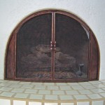 Fire doors for beehive fireplace